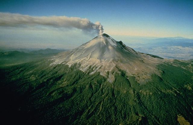 A plume of steam and ash rises above Popocatépetl