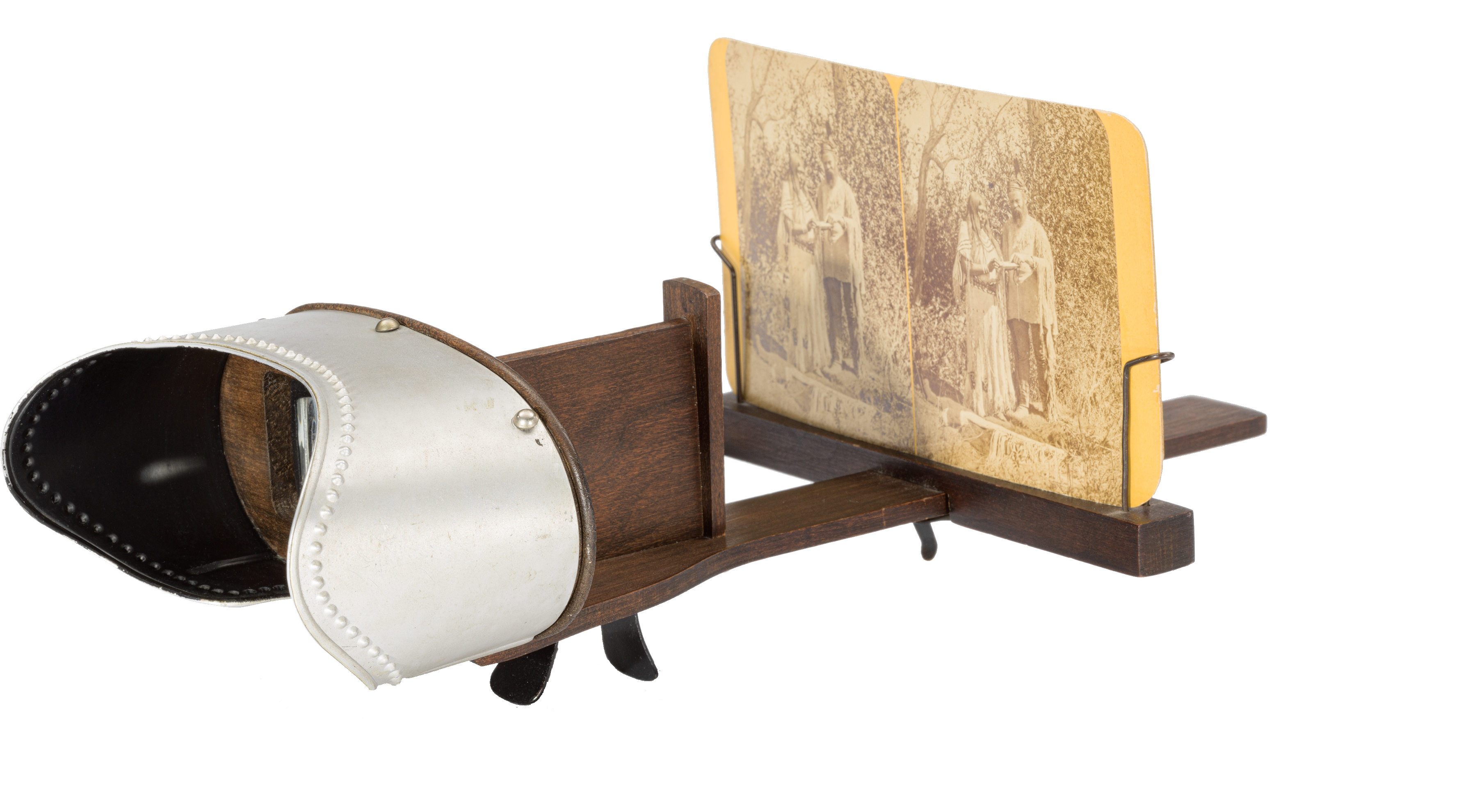 a wooden photograph view finder with an old photo in grasp